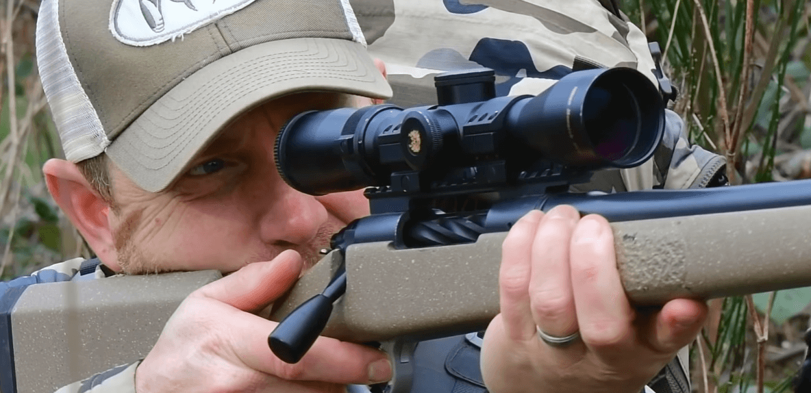 shooter with compact scope and rifle