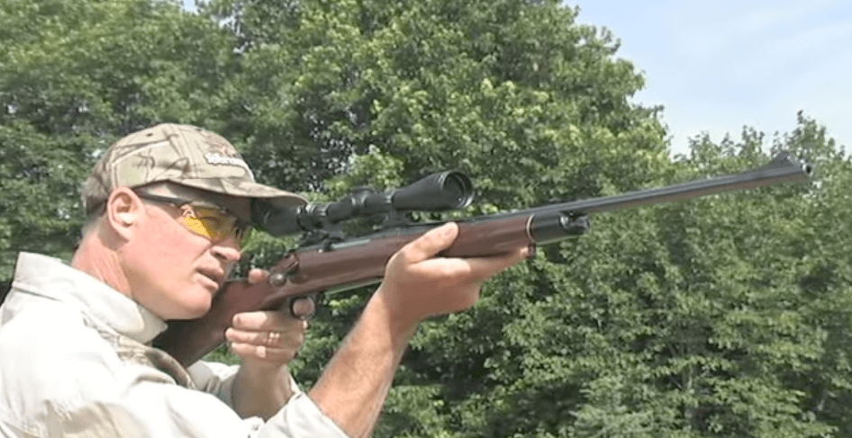 hunter with best 3-9x40 scope and rifle